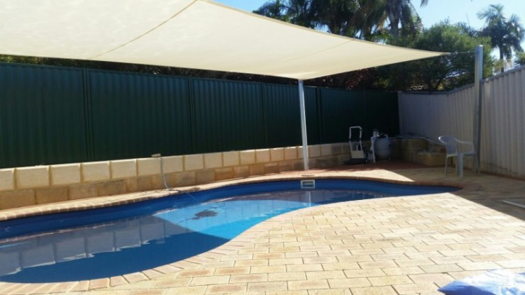 After Photos of paving around pool and shade sail