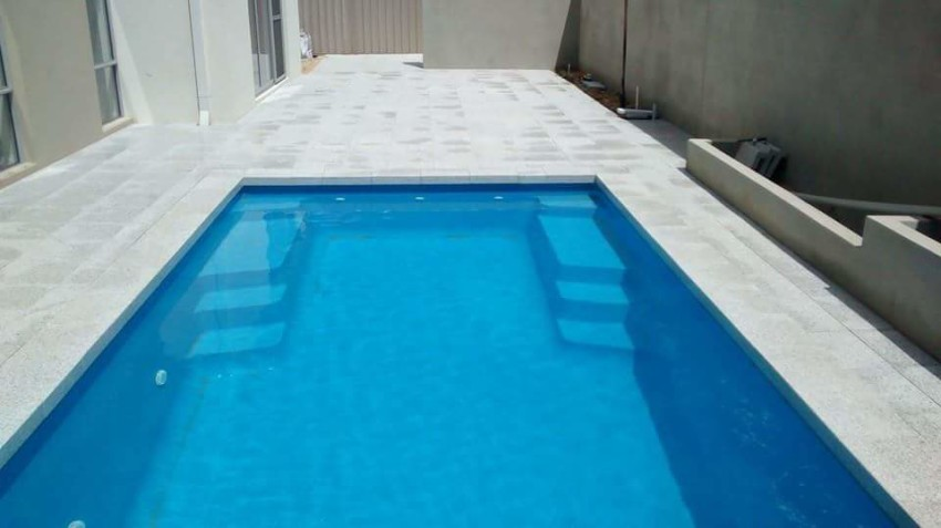 After photo of paving around swimming pool