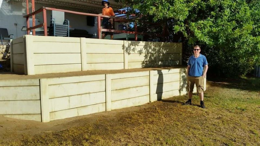 Owner of the property is very happy with his new panel and post retaining wall.